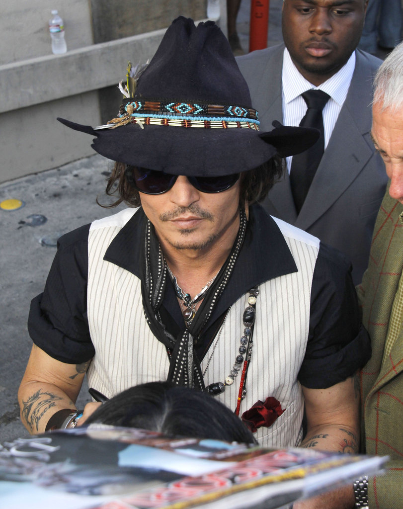 Johnny Depp signed pictures at the Jimmy Kimmel Live studios.