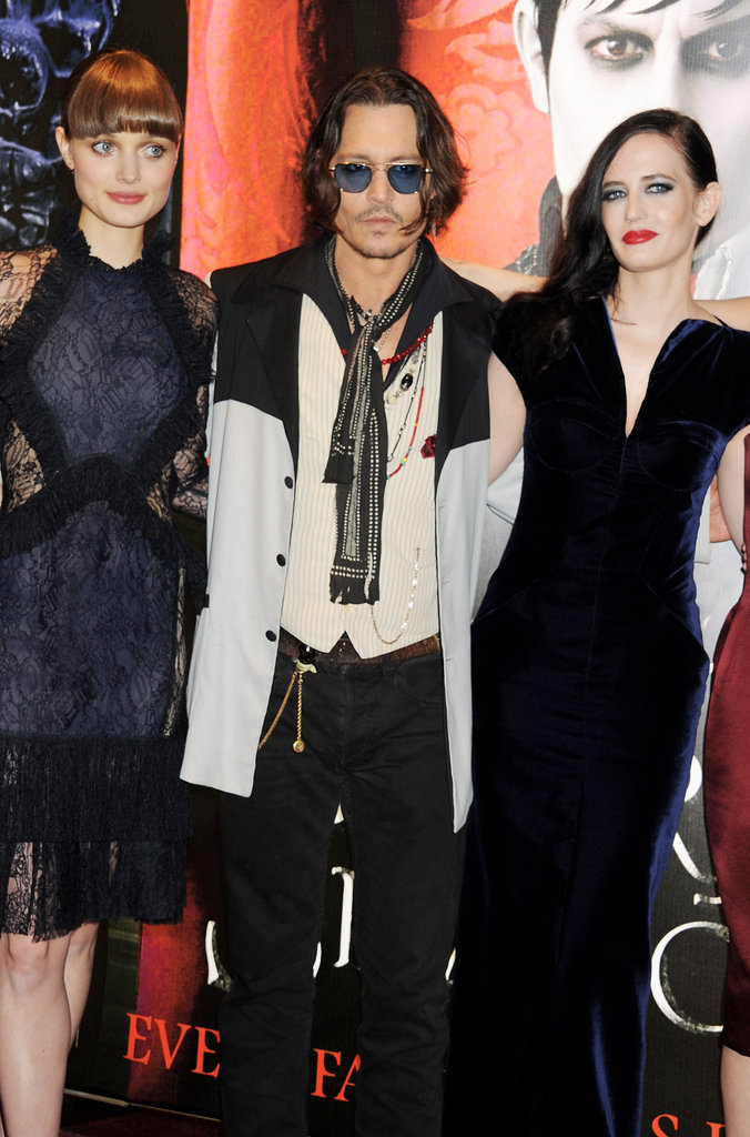 Johnny Depp posed with his leading ladies at the Dark Shadows premiere.