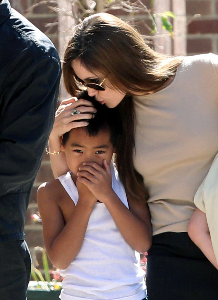Angelina Jolie planted a kiss on son Maddox Jolie-Pitt's head in New Orleans while the two took a stroll in May 2011.