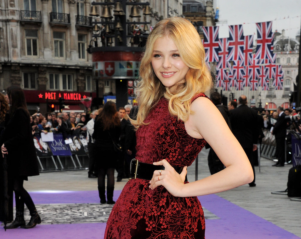Chloe Moretz wore a red belted dress to the Dark Shadows premiere in London.