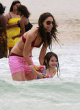 Katie Holmes and daughter Suri Cruise splashed in the ocean together during a trip to Miami in June 2011.