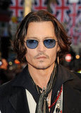 Johnny Depp wore blue tinted shades to the Dark Shadows premiere.