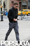 Justin Timberlake went for a walk with a coffee in NYC.