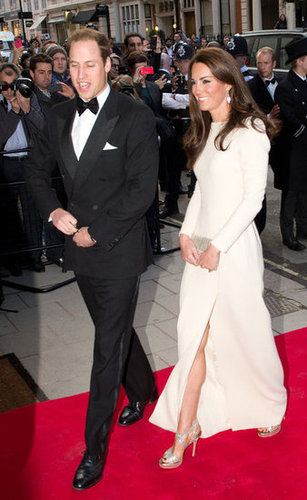 The gorgeous couple made their way down the red carpet — we love the daring thigh-high slit on Kate's white Roland Mouret gown.
