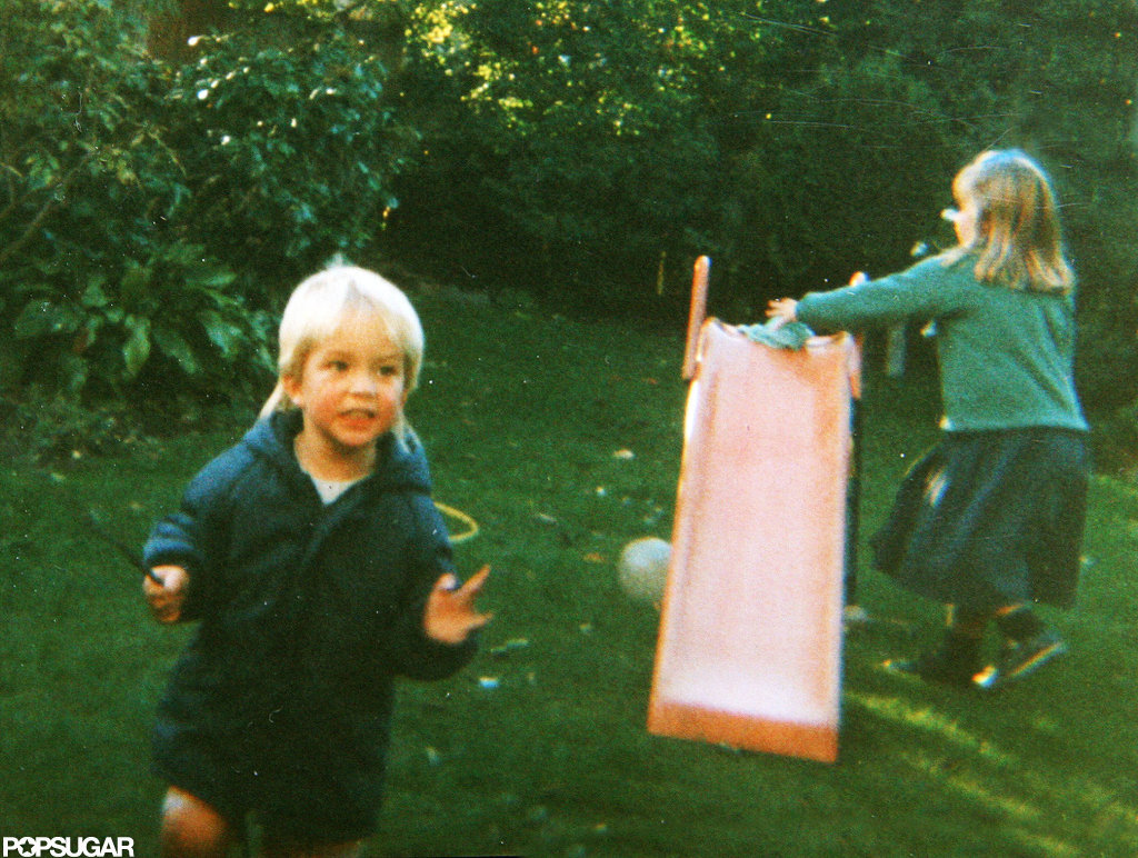 Robert Pattinson played on a slide with one of his sisters.