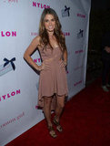 Nikki Reed showed off her figure in a tan dress.