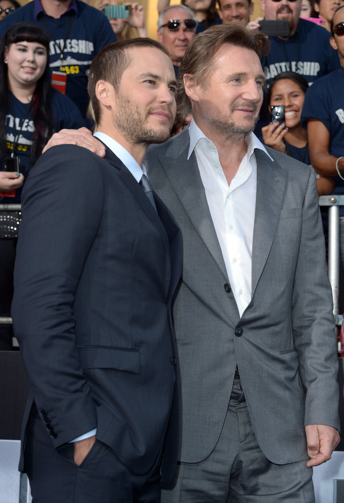 Taylor Kitsch and Liam Neeson embraced on the blue carpet at the premiere of Battleship in LA.