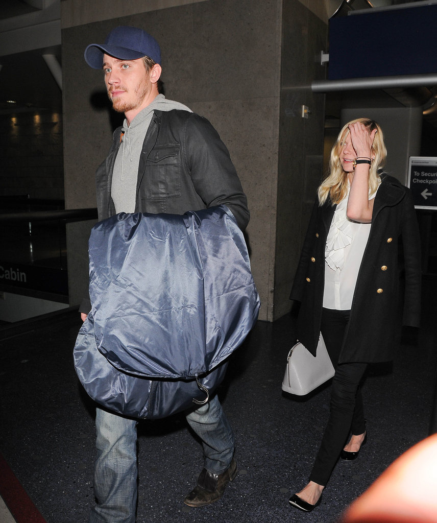 Kirsten Dunst and Garrett Hedlund traveled through LAX together.