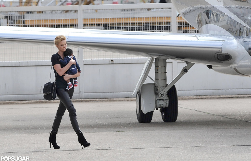 Charlize Theron held on tight to Jackson.