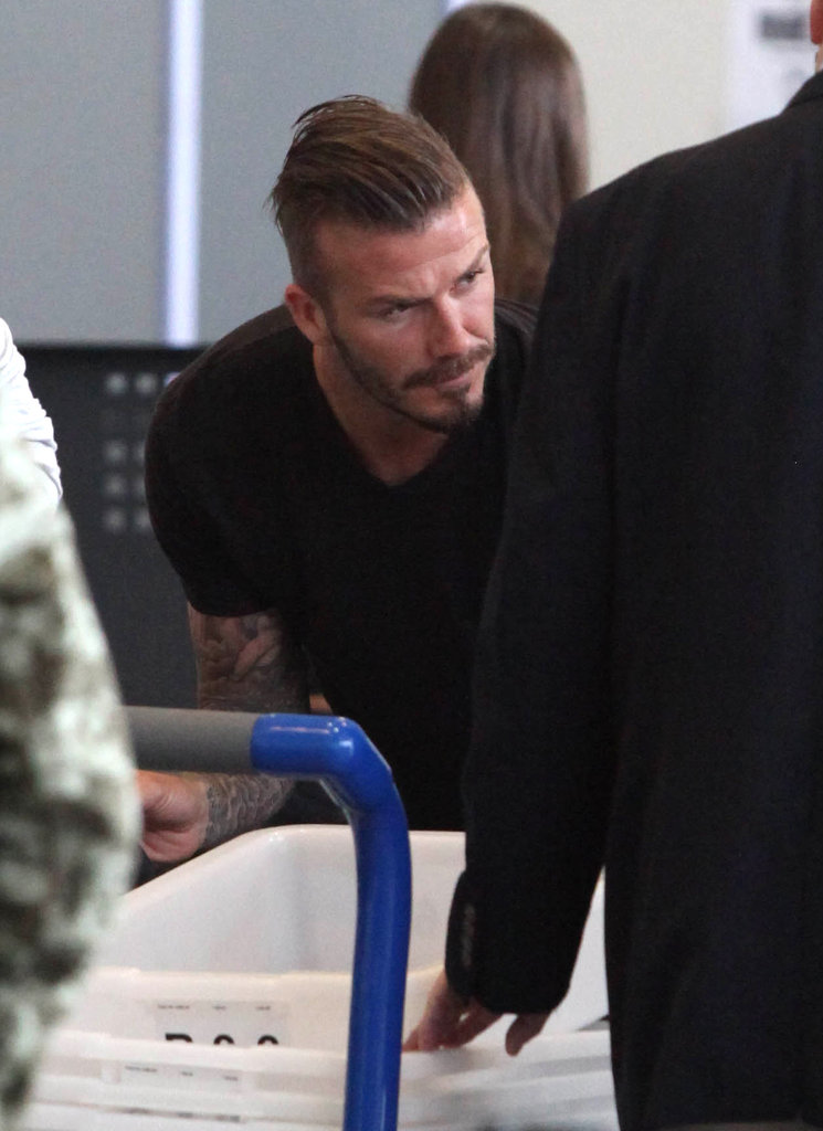 David Beckham put his belongings through security.