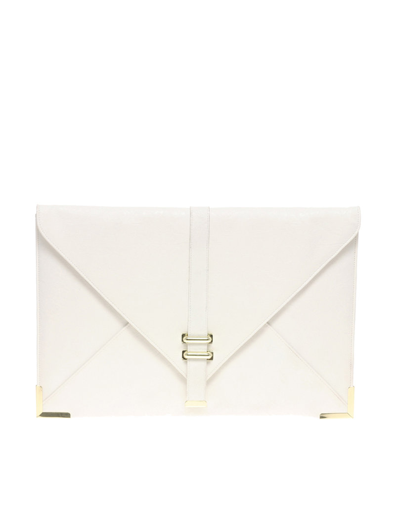 This envelope clutch gives a clean pop of color against an LBD or floral frock.  ASOS Slot Through Envelope Clutch ($35)