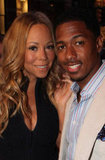 Mariah Carey and Nick Cannon got close at the Project Canvas Exhibition & Art Gala in NYC.
