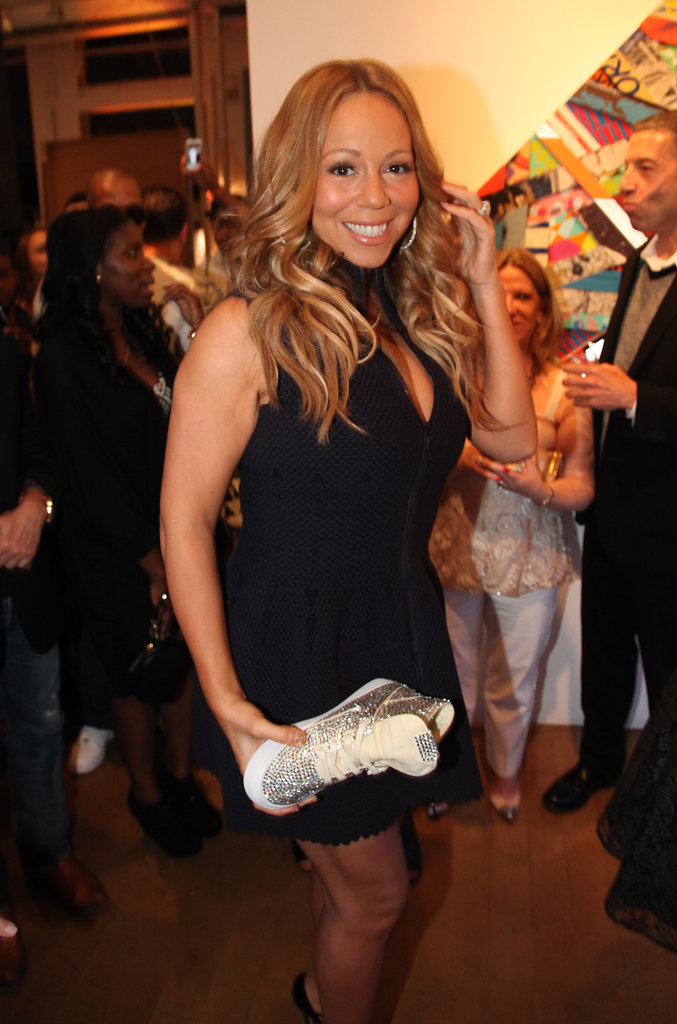 Mariah Carey showed off a piece of artwork at the Project Canvas Exhibition & Art Gala in NYC.