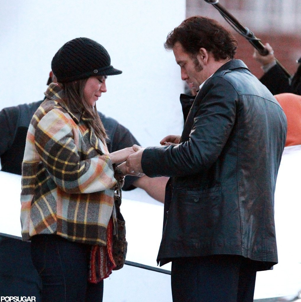 Clive Owen slipped a ring on Mila Kunis's hand on the set of Blood Ties in NYC.
