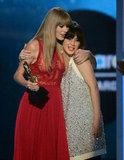 Taylor Swift hugged Zooey Deschanel after receiving her Billboard Music Award in May 2012.