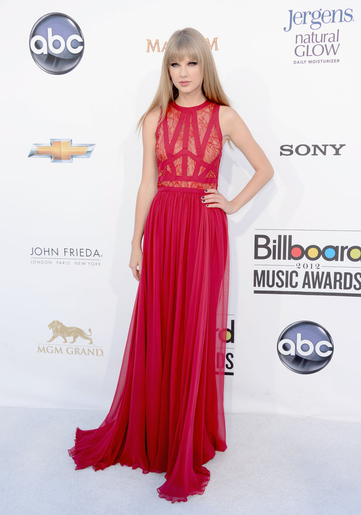 Taylor Swift wowed (and surprised us) in a sexy red Elie Saab number at the 2012 Billboard Music Awards — can we talk about that lace-infused bodice? We love that she rocked a more unexpected dress with her signature approach to minimal accessories.