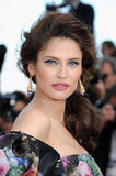 Bianca Balti accessorised with gold statement earrings and a side-swept ponytail.
