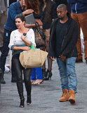 Kim Kardashian and Kanye West looked cute together as they walked through the Vogue Italia photo shoot set.