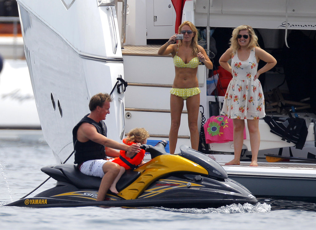 Bikini-clad Spice Girl Geri Halliwell snapped a photo from the deck of a yacht during a June 2011 family vacation.