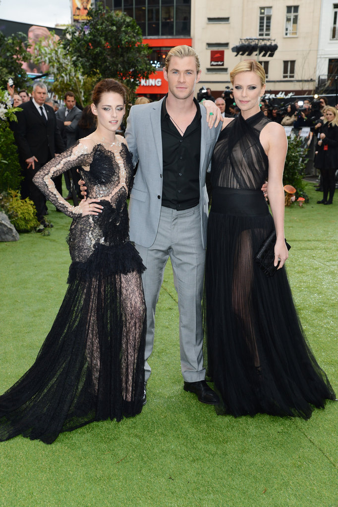 SWATH costars Kristen Stewart, Chris Hemsworth, and Charlize Theron posed for a photo at the London premiere.