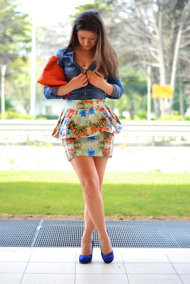 We love how this style setter balanced out a statement print and peplum on her skirt with a more relaxed-feeling denim button-down. Try this style for afternoon cocktails.  Photo courtesy of Lookbook.nu