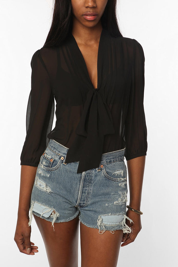 This sheer tie-neck blouse is a wardrobe essential and if you're going for sexy, just wear a bright lacy bra underneath for a subtle pop of color. Urban Outfitters Pins and Needles Chiffon Tie Neck Tunic ($59)