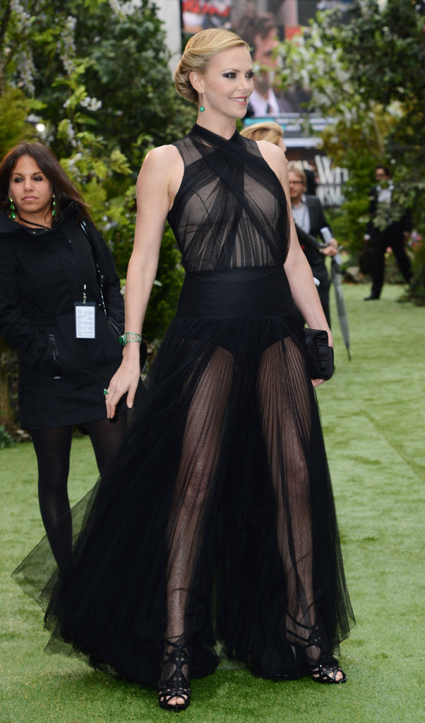 The gown's sheer skirt and peek-a-boo bodice highlight Charlize's flawless figure.