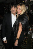 Kate Moss posed with The Rolling Stones' bassist Ronnie Wood, who was performing at the event.