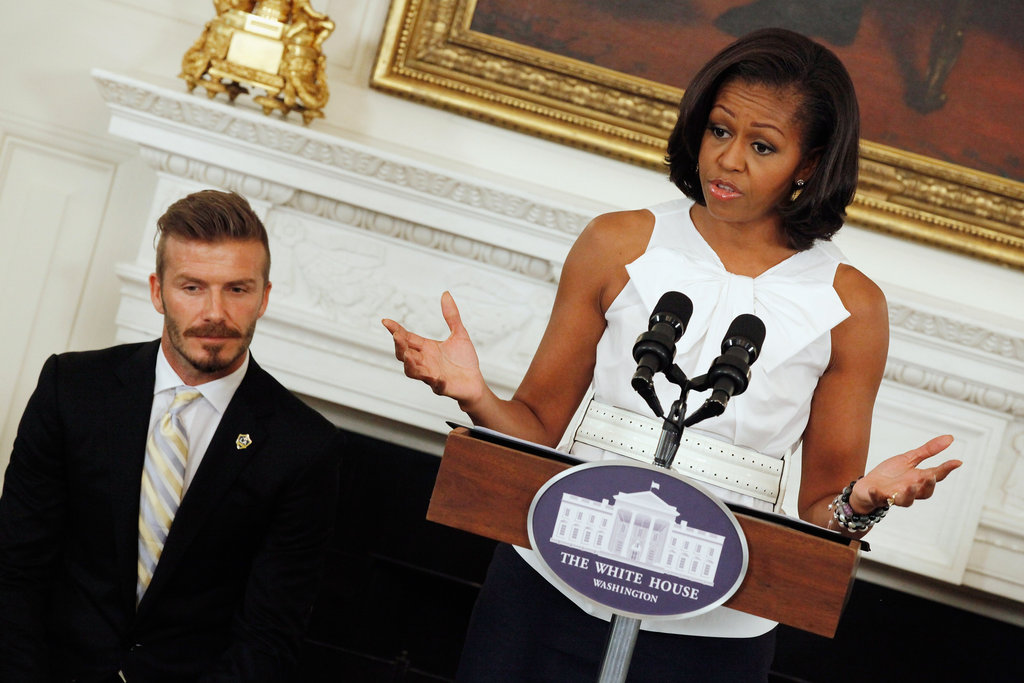 David Beckham listened to Michelle Obama speak at the White House.