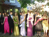 """I wore a [purple] Nicole Miller dress to prom — little did I know that a dozen other girls would show up wearing the same style in different colors! I was horrified at the time."" — Anna Roberts, editorial assistant"