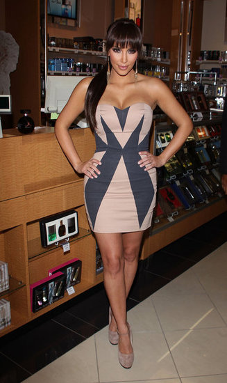This Sass & Bide strapless geometric dress, currently bidding at $510, that Kim wore while promoting her fragrance in Camarillo in 2010 would make a fabulous entrance at any cocktail or bachelorette party. Maybe you can pair it up with the L.A.M.B. shoes.