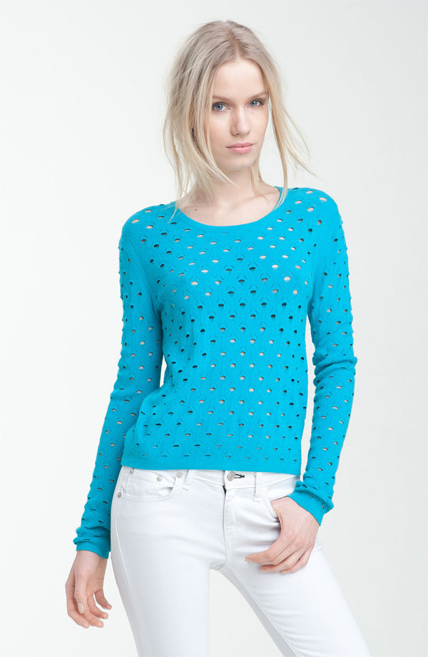 Pop this sweater over a hot pink or bright yellow tank for a burst of cool colorblocking. Rag & Bone Eyelet Pullover ($275)