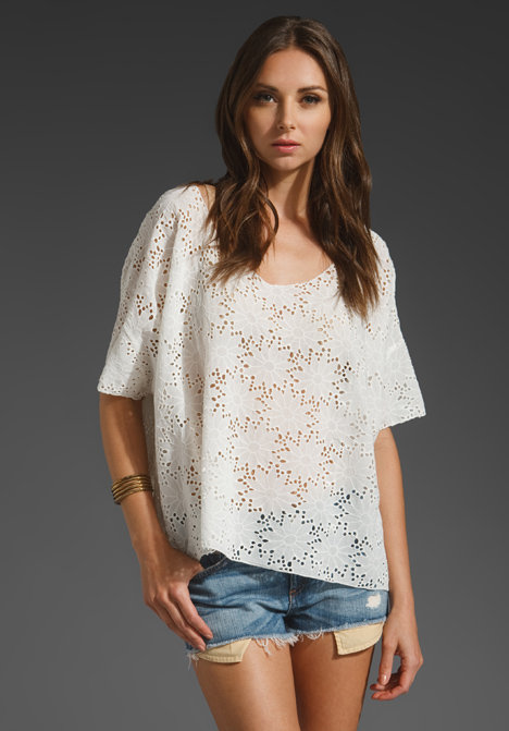 This slouchy eyelet poncho top looks cool and bohemian when paired with denim shorts. Love Sam Eyelet Poncho ($182)