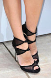 "Let's zoom in on Diane Kruger's slick Jimmy Choo ""Katima"" sandals — definitely a statement shoe."