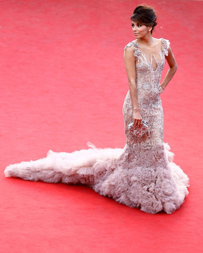 A stunning shot of Eva Longoria's Marchesa gown, train, and beaded clutch.