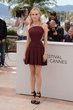 "Leave it to Diane Kruger to set the Cannes style bar very, very high. For the film jury's official photocall, she wore a maroon-hued Versus Fall '12 dress that was nothing short of sexy, and her strappy Jimmy Choo ""Katima"" sandals certainly added the vampy finish."