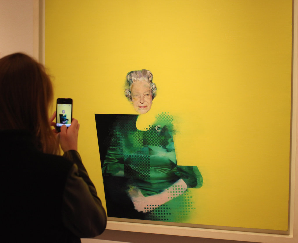 "A woman photographed a painting of Her Majesty Queen Elizabeth II by artist Justin Mortimer titled ""The Queen."""