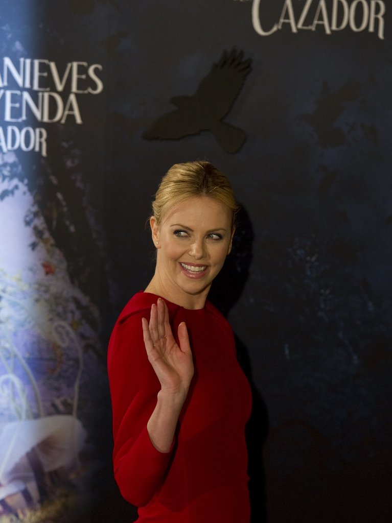 Charlize Theron waved at the Snow White and the Huntsman photocall in Madrid.