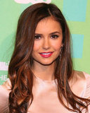 Nina Dobrev wore a dark pink lip shade with her dress.