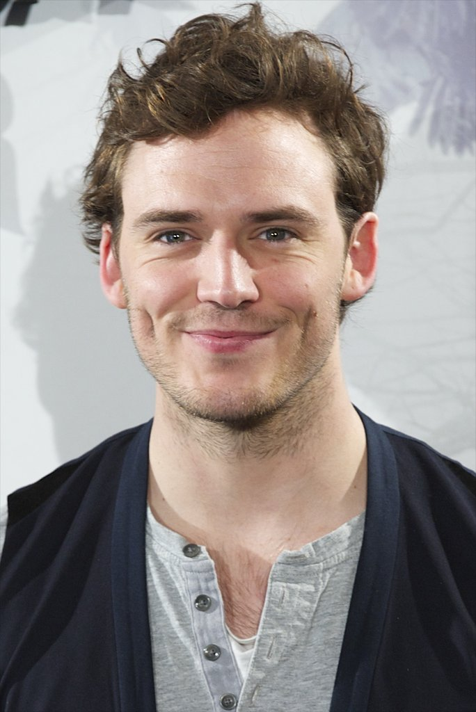 Sam Claflin gave a happy smile at the Snow White and the Huntsman photocall in Madrid.