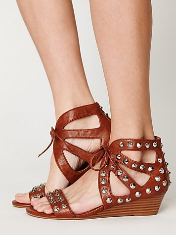 Studs and laces amp up this neutral pair that'll still go with everything in your closet.  Jeffrey Campbell Paige Studded Sandal ($158)