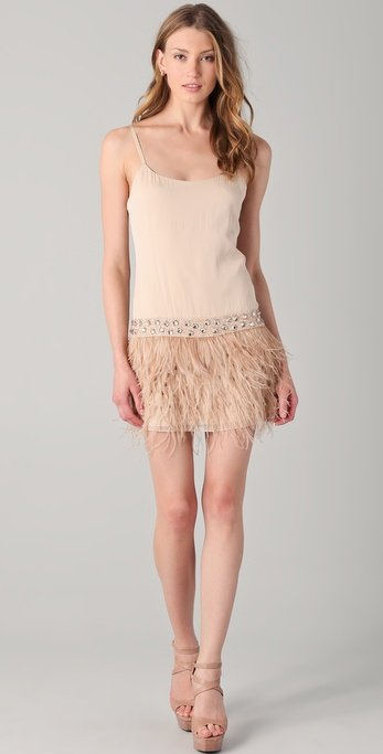 This sexy nude dress would look great with a black blazer or a drapey bed jacket.  Alice + Olivia Lydia Feather Tank Dress ($550)