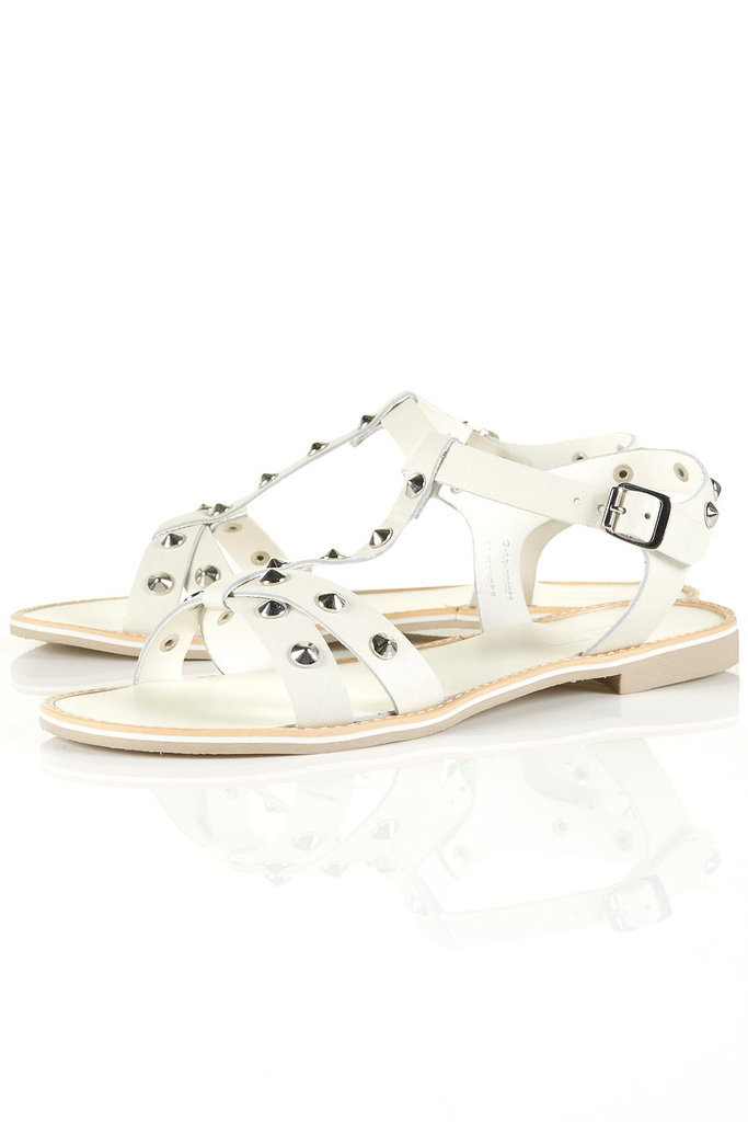 We love the effect of easy white sandals contrasted with tougher studs.  Topshop Freddie Studded T-Bar Sandals ($96)
