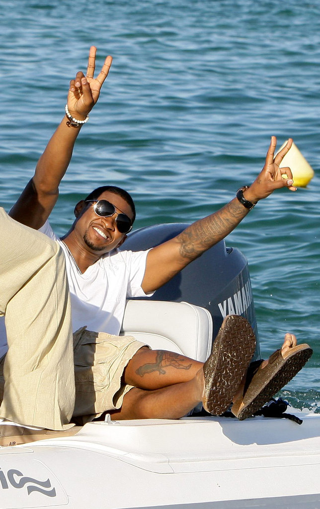 Usher had a ball on a boat during an August 2009 trip to St.Tropez.