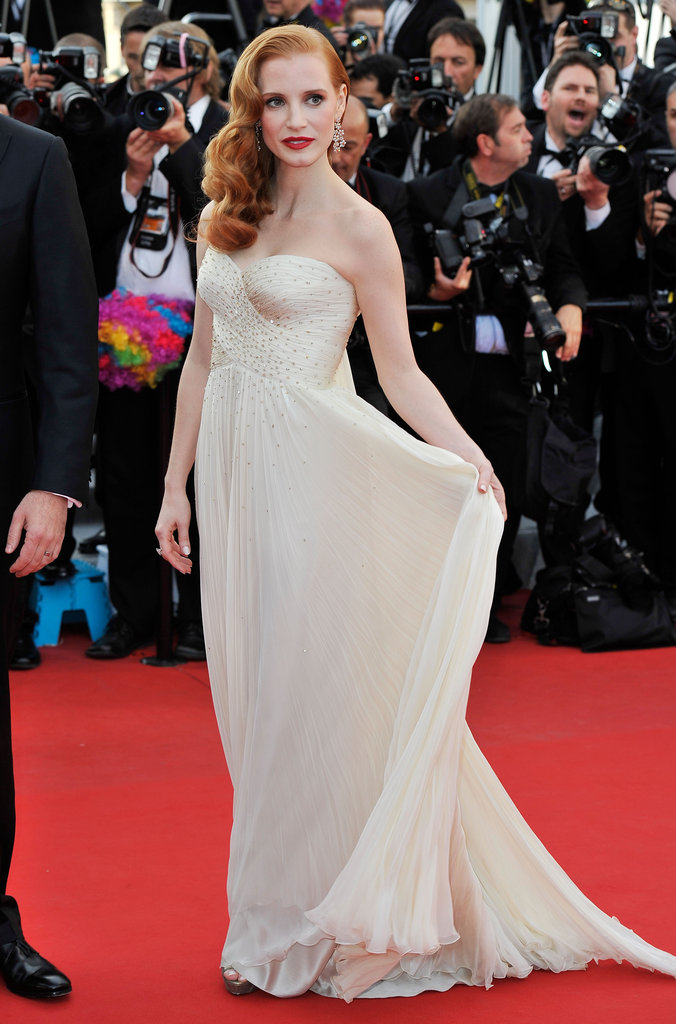 Jessica Chastain looked ravishing in an elegant, strapless ivory-hued Giorgio Armani dress, Chopard diamond earrings, and side-swept waves on the Madagascar 3 red carpet.