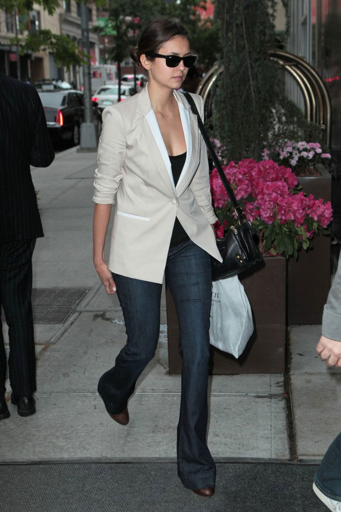 Nina Dobrev gave us a sophisticated spin on denim (and another look to love!) with a white blazer and heels.