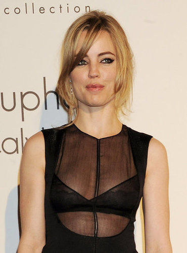Melissa George showed a little skin via a sheer-inset bodice.