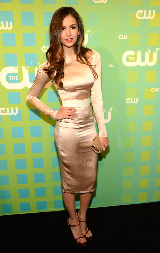 Nina Dobrev took to the CW Upfronts in an ultraelegant fitted sheath and Veronica Lake-inspired waves.