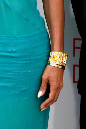Let's zoom in on that cool gold cuff Jada wore at the second Madagascar 3 photocall.