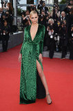 Model and actress Natasha Poly showed off her leg via one seriously striking thigh-high split. The beauty donned a daring V-neck green velvet Gucci dress for the Madagascar 3: Europe's Most Wanted Cannes premiere and paired the look with emerald-green drop earrings.